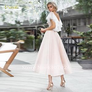 Image 2 - Loverxu Shimmering V Neck A Line Cocktail Dress Chic Applique Cap Sleeve Backless Tea Length Party Dresses Ever Pretty Plus Size