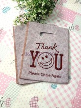 Free Shipping 500pcs/lot 15*20cm Coffee Cute Face Boutique Plastic Bags With Handle Gift Garment Underwear Package Cloth Shop(China (Mainland))