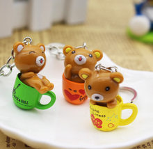 pcs/lot Kawaii Cartoon Animal Action Figure Pendant Key chain PVC Bear and Cup Keychain For Women Girls Gifts Car Bags Keyring(China)