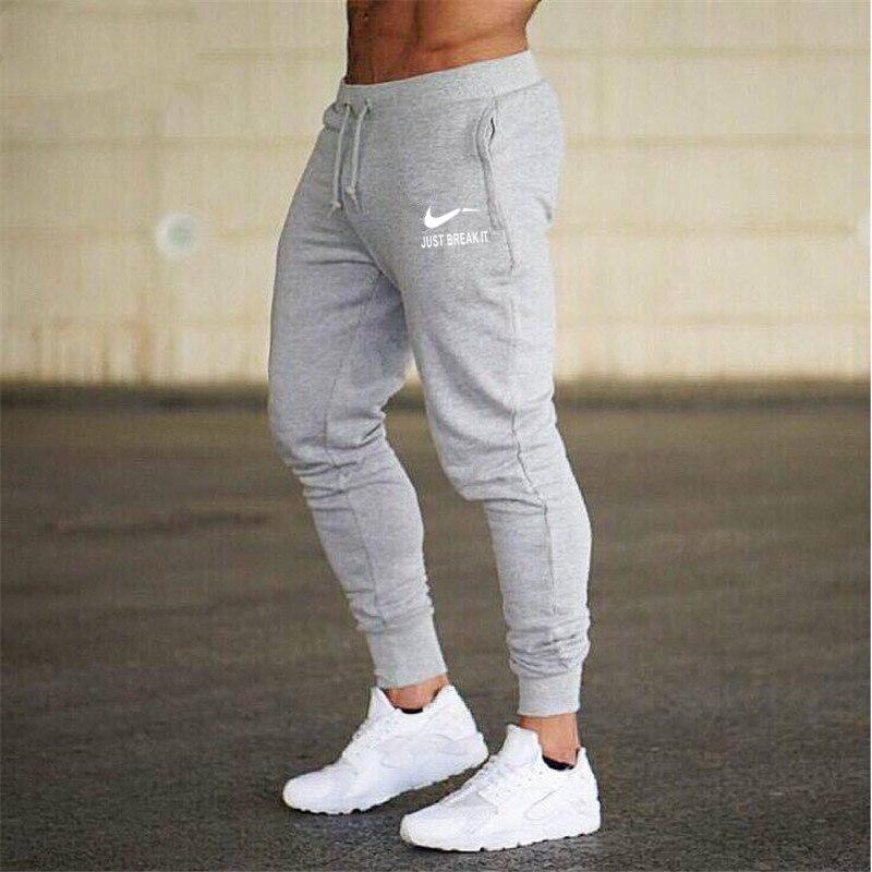 2018 nuevos hombres camisetas de marca, para Hombre Pantalones casuales pantalones de chándal Jogger gris Casual de algodón elástico gimnasios Fitness entrenamiento pan