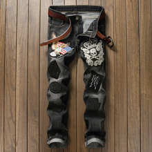 Novelty Skull Embroidery Man Rivet font b Jeans b font Vintage Flag Eagle Applique Trousers