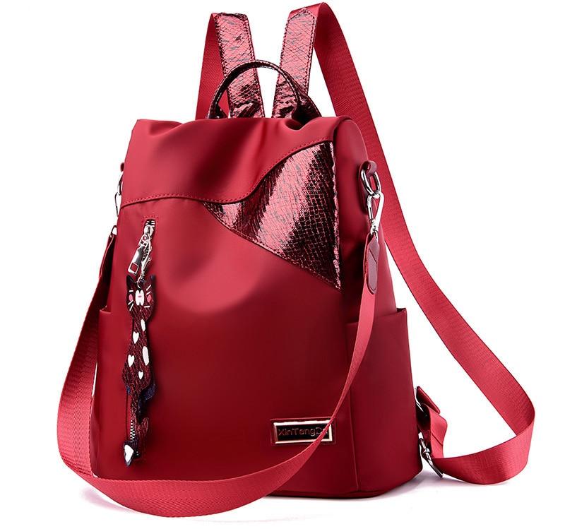 HTB1wAN.MhjaK1RjSZFAq6zdLFXaU Simple style ladies backpack anti-theft Oxford cloth tarpaulin stitching sequins juvenile college bag purse Bagpack Mochila