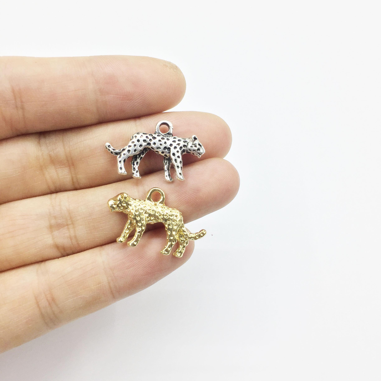 Eruifa 10pcs 15*25mm Pretty Leopard Zinc alloy Jewelry DIY Charms Pendant Necklace,Eearrings 2 Colors(China)