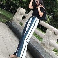 Pantalones rayas verticales cintura alta bota ancha 1