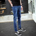 The new spring and summer 2016 brand of men's jeans. SLIM STRAIGHT elastic jeans male feet