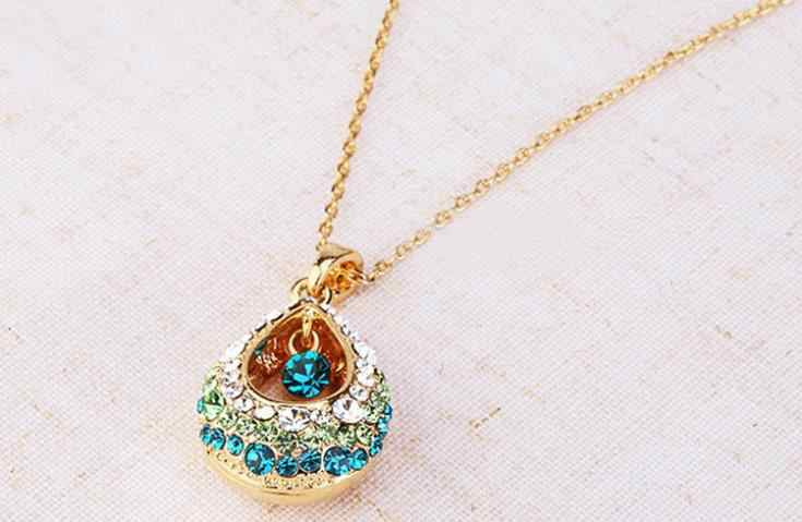 The new European and American female crystal teardrop necklace pendant gift hollow droplets