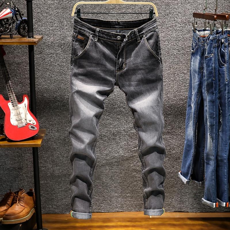 c2bbc026ad Pantalones vaqueros ajustados de mezclilla para hombre pantalones pitillo  elásticos sólidos vaqueros largos nuevos vaqueros de moda para hombre  Pantalones ...