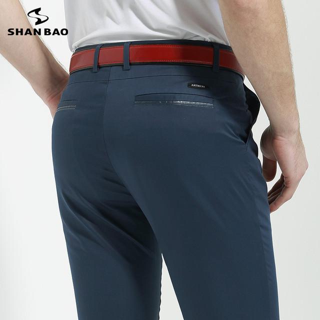 SHAN BAO marca mercerizado de algodón pantalones casuales de los hombres 11 color primavera 2017 de la buena calidad de color sólido sección delgada pantalones Delgados 8857