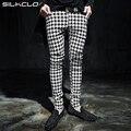 2016 nova moda Outono estilo Punk Nightclub mostrar calças pés calças dos homens casual slim fit plaid Houndstooth grade dos homens M-XXL