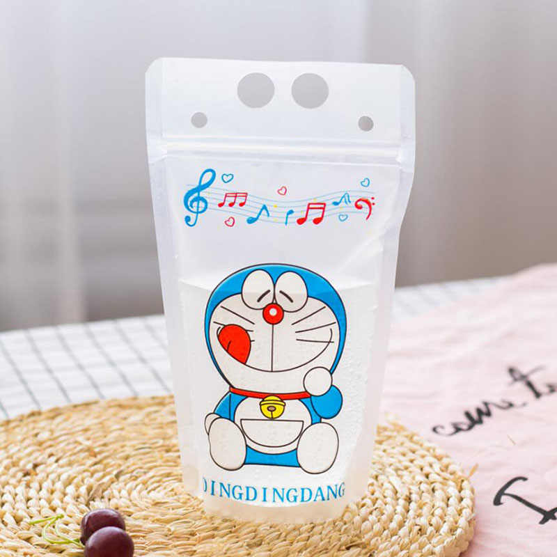 100 Pcs Cute Blue Cat Cartoon Colorful Plastic Drink Packaging Bag Pouch for Beverage Juice Milk Coffee,with Holes Handle 450ml