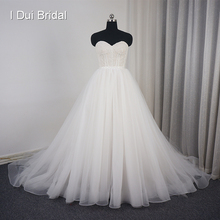 Przepiękna suknia balowa suknia ślubna tiulowa warstwa koronkowy gorset zroszony podszewka szampana