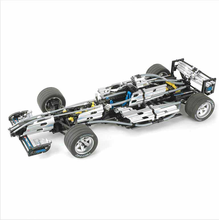 цена  1486Pcs Yile 8458 Technics Serie The Ultimate Sliver F1 Racing Car Educational Building Blocks Bricks Toys  онлайн в 2017 году