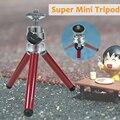 Nueva Moda Mini Trípode Tabla Trípode RÉFLEX DIGITAL Portátil Ligero 100g de Pie 13-27 cm Trípode de Viaje con el Móvil Soporte para teléfono