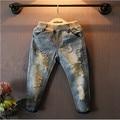 Малыша 2016 девочка джинсы корейский стиль мода стиральная граффити джинсовые брюки новые рваные джинсы для девочек 2-7Y