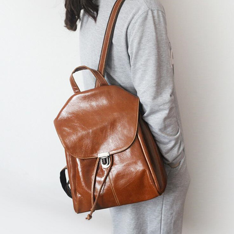 ФОТО Famous Brand Backpack Women Backpacks Solid Vintage Girls School Bags for Girls Black Genuine  Leather Women Casual Backpack