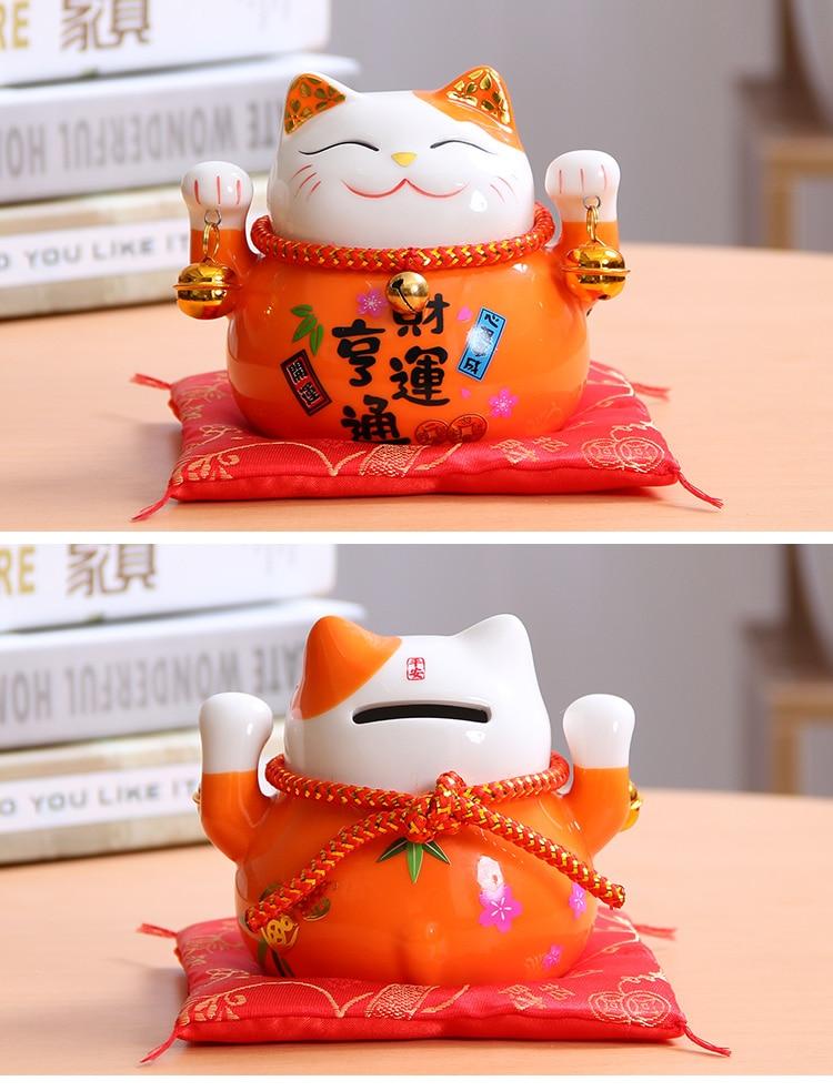 Foto Maneki Neko (Gato de la suerte) de cerámica color naranja para la fortuna