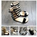 2016 estilo del verano del bebé niñas zapatos Niños zapatos niños de cuero gladiador Romano tacones Altos de punta abierta niña moda standals