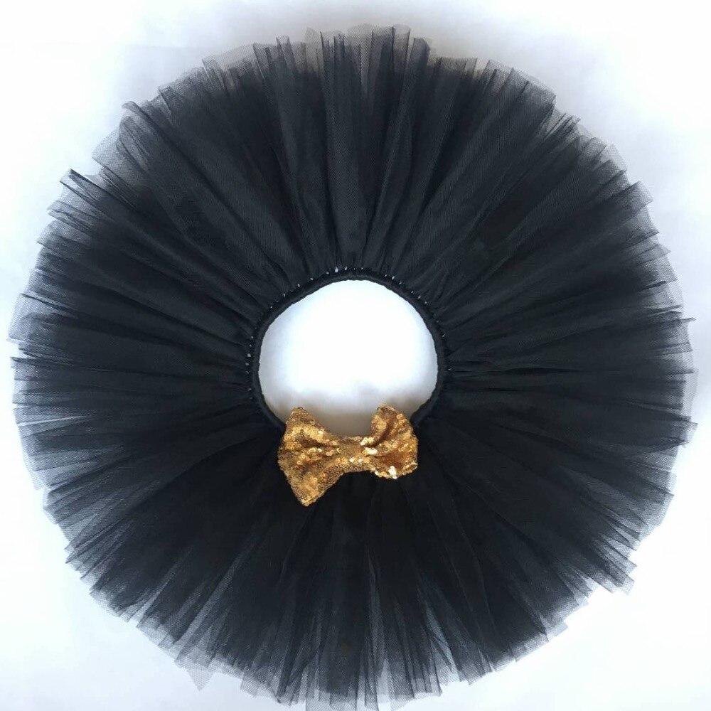 a9ba11c67 Niñas tutú negro Faldas bebé mullido tulle pettiskirt danza Tutu con arco  del cequi del oro embroma Faldas niños Faldas