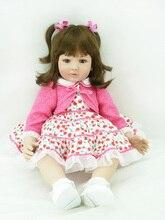 Muñeca reborn de 55 cm con chaqueta rosa