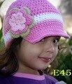 Crochet bebé sombrero hecho a mano lindo Baby pink Flower gorra de vendedor de periódicos del recién nacido Photo props