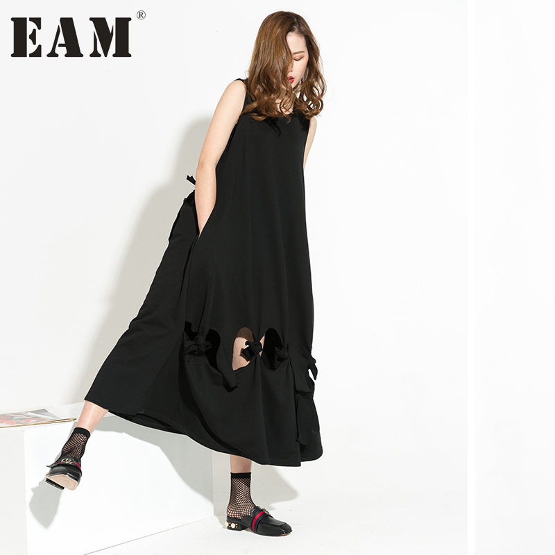 EAM 2017 new autumn Big Size Crossing Bandage Hollow Out Hem Oversize Sleeveless solid color