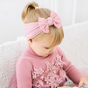 Image 2 - 100 stks/partij, Groothandel Brede Nylon Boog Headwrap, One size fits meest Knoop Boog Nylon Hoofdbanden 27 Kleuren beschikbaar