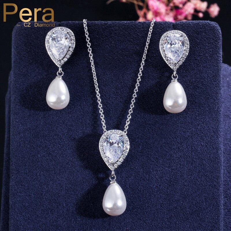 fb39157099ce Collar y pendientes de circonita cúbica con corte de agua grande para  fiesta de aniversario con diseño de perla simulada elegante Pera para mujer  ...