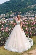 Романтические свадебные платья трапециевидной формы с рукавами