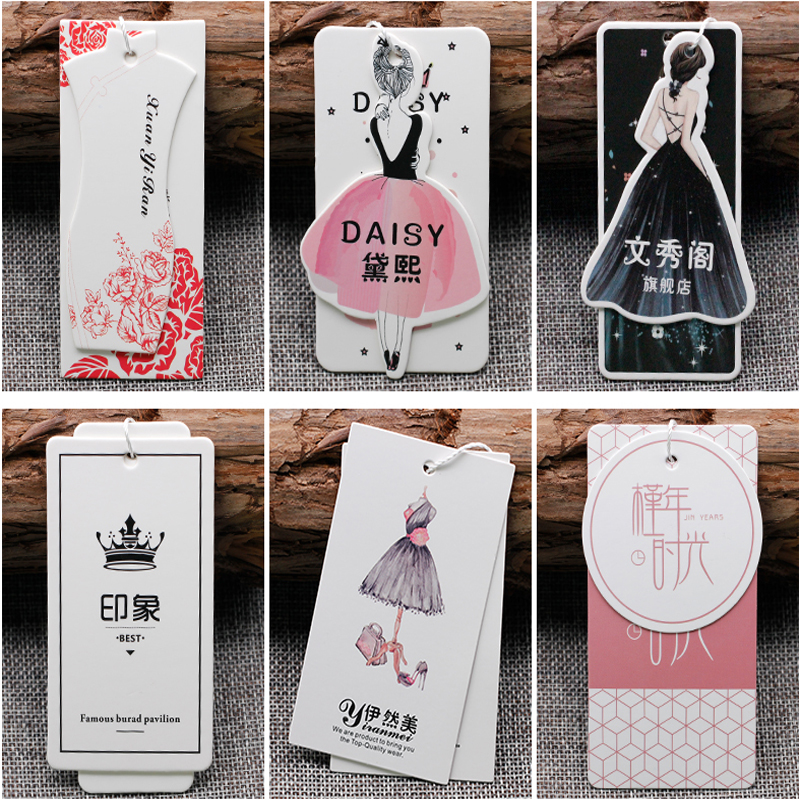 Customized garment woman 39 s dress paper printing hangtag label 1000 lot Premium Product 800gsm Thick White Cardboard Embossed Log in Garment Tags from Home amp Garden