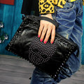 Free shipping Pure sheepskin hand bag shoulder bag skull head rivet hand bag personality one shoulder aslant leather handbag