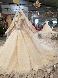 Image 4 - Ls11209 웨딩 베일 높은 목 캡 슬리브와 크리스탈 웨딩 드레스 기차 bruidsjurken 투명 웨딩 드레스