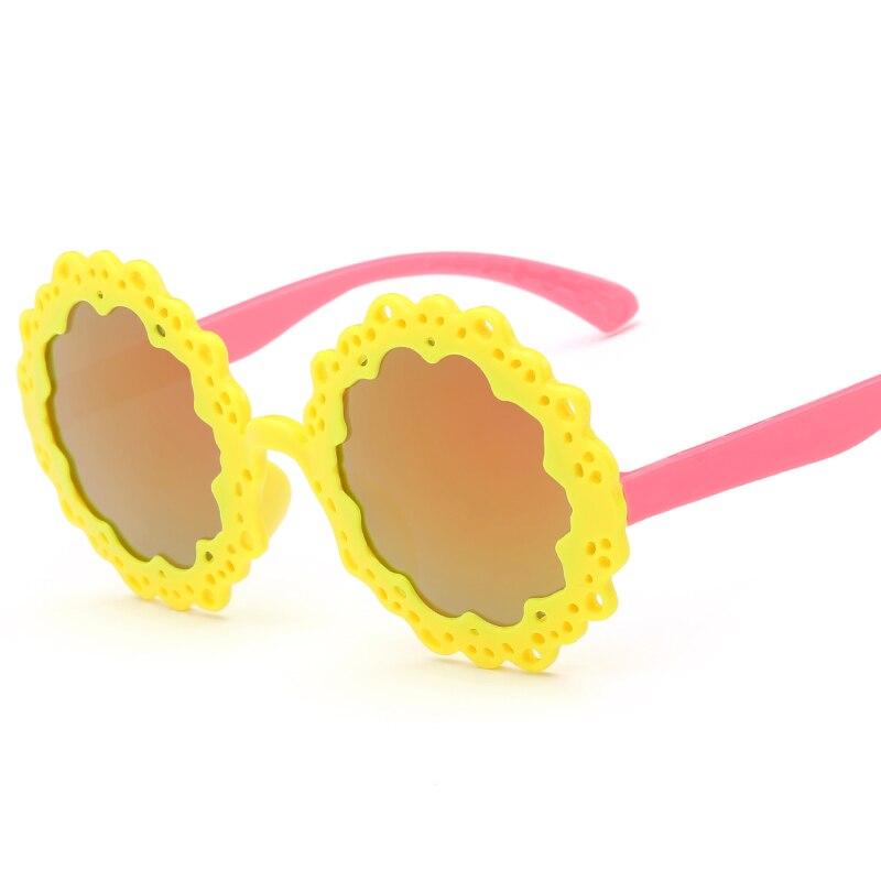 Laura Fairy moda estilo flor forma redonda diseño Gafas de sol 100%  protección UV niños Niños Niñas Sol Gafas oculos infantil en Gafas de Sol  de Mamá y bebé ... cc7cdfa82e57