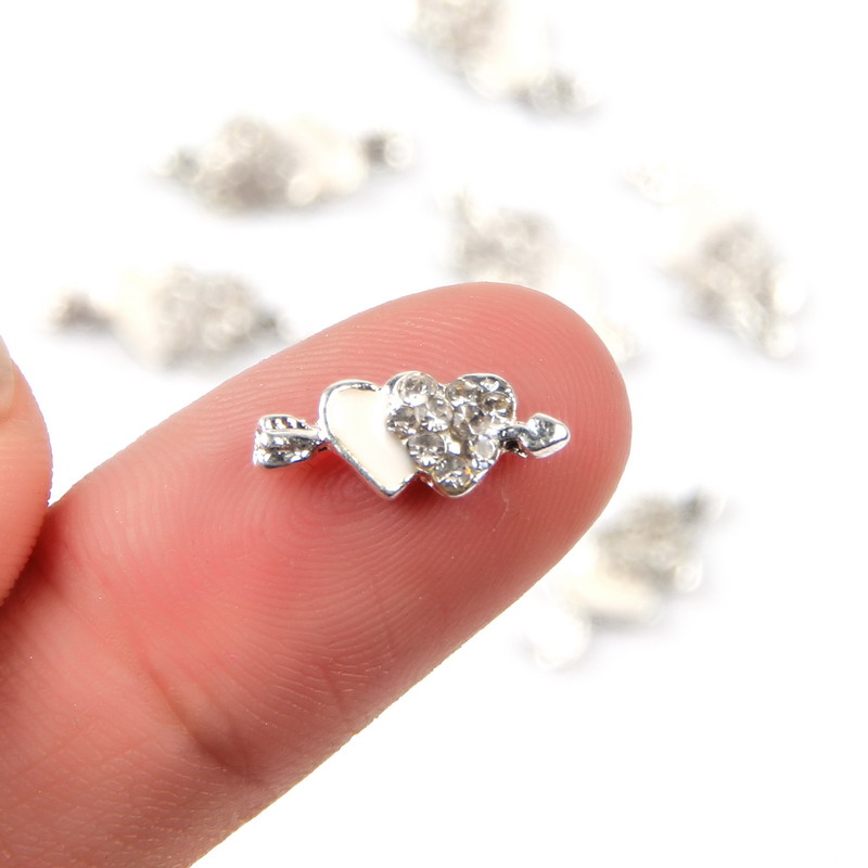 ELESSICAL 10Pcs Lot Silver Double Piercing Hearts 3D Nail Art Decorations Alloy Charms Rhinestones For Manicure MA0017 In