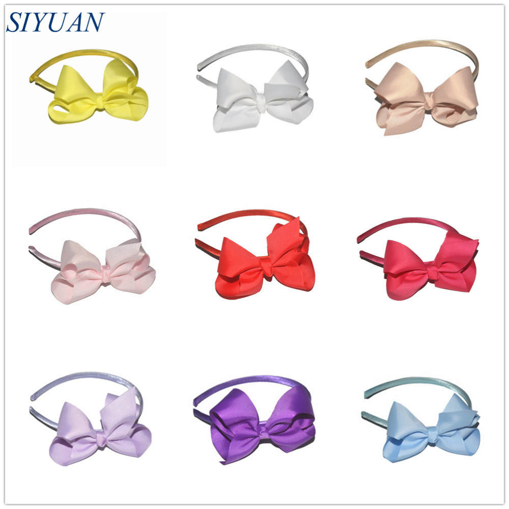 Promotional 50pcs lot 12 Colors Plastic Headband with 4 5 inch Grosgrain Ribbon Bow Mother Kids