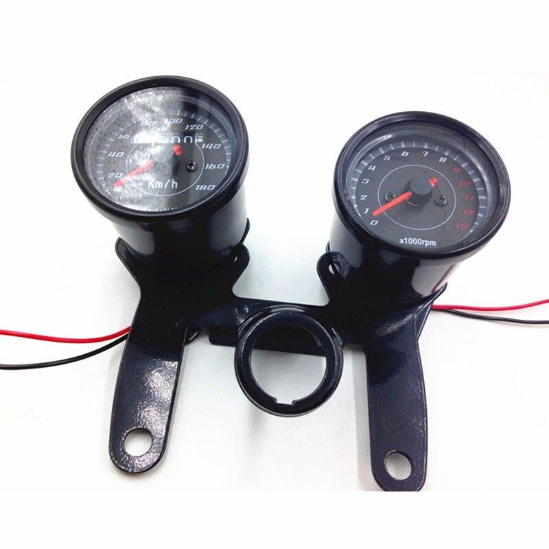 цена Universal Motorcycle Black Surface 12V LED Tachometer Tacho Gauge Odometer Speedometer Gauge Cafe Racer Bobber