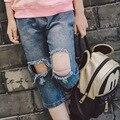 Джинсы 2017 Весна и Осень Корейской версии мальчиков и девочек личность отверстие брюки детские брюки