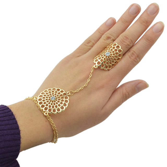 Flower bracelet with rhinestones. Gold and Silver color