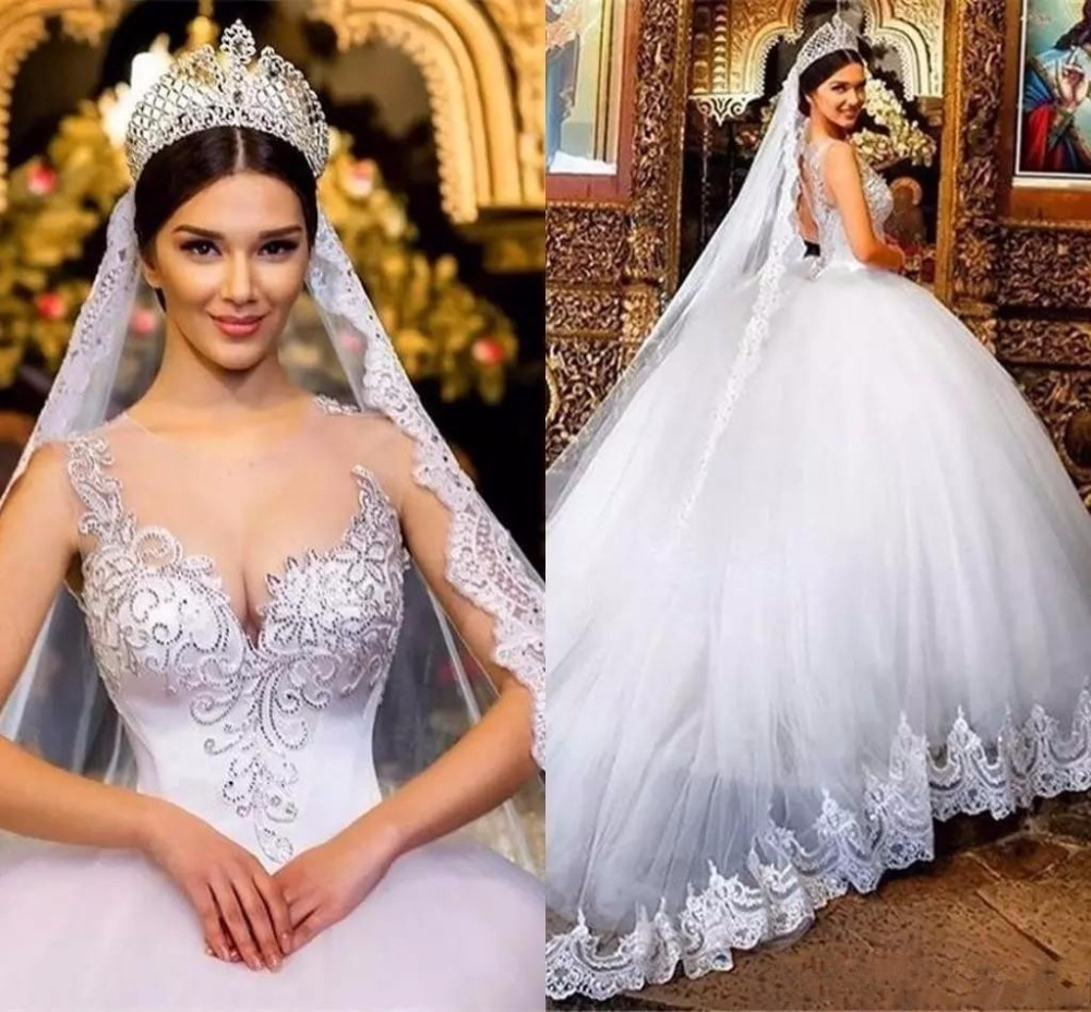 2019 Ball Gown Wedding Dresses Sheer Neck Lace Applique Beads Crystal Hollow Back Court Train Back Plus Size Bridal Gowns