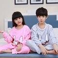 Pijamas de franela para niños de invierno 2016 niños Niñas Coral fleece manga larga caliente pijamas conjuntos niños ropa de Navidad por mayor