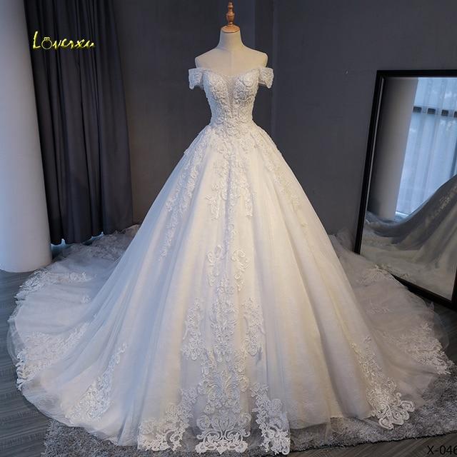 Loverxu Gorgeous Appliques Lace Chapel Train A-Line Wedding Dress 2021 Luxury Beaded Boat Neck Sexy Bridal Gown Vestido De Noiva 1