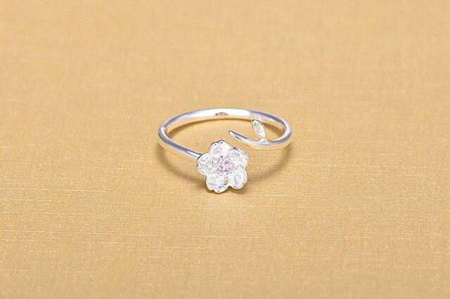 Фото женское кольцо из серебра 925 пробы с цветком вишни цена