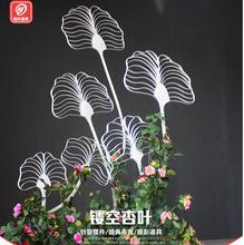The new iron art ginkgo leaf road leads the stage of wedding decoration stage.