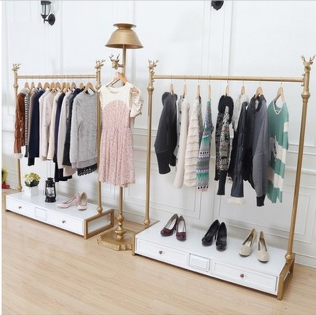 high grade iron clothing rack clothing store display racks in the clothing racks island shelf. Black Bedroom Furniture Sets. Home Design Ideas