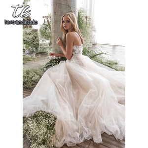 Image 5 - Spaghetti Straps Scoop Wedding Dress Sleeveless 3D Flower Lace Appliques Backless A Line Tulle Illusion Bridal Gown with Train