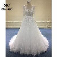 Elegant Wedding Dresses 2018 Sheer Lace Bridal Gowns Long Sleeves Appliques Beaded Sashes Tulle Vestido De