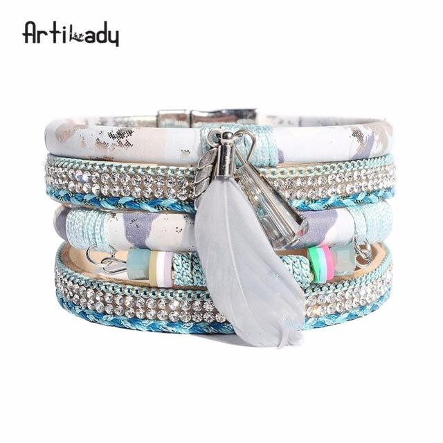 ef08fae5ed67 Artilady mujer brazaletes pulseras pulsera de cuero de la pluma de cristal  de encanto brazalete de. Sitúa el cursor encima para ...