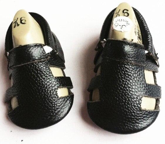 Comercio al por mayor 50 par/lote 2016 nuevo verano negro lether Genuino de la vaca del bebé niños niñas zapatos Primeros Caminante mocasines para el recién nacido bebés