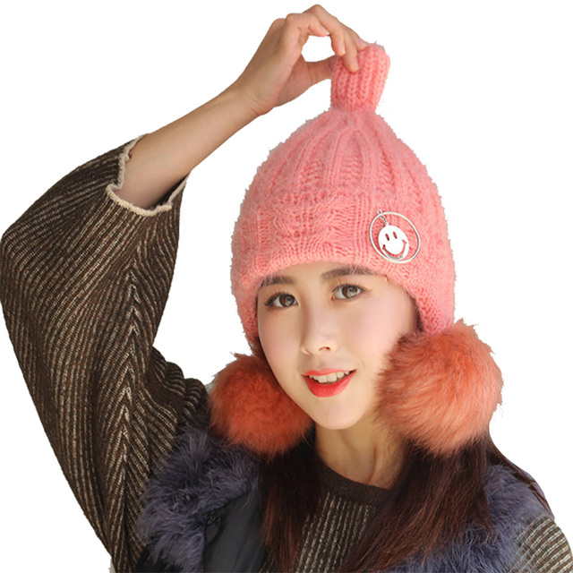 b25b085f1a0 2018 New Knitted Woolen Women s Hats Fashion Pompom Hairball Warm Ear A Cap  Nipple Type Winter Student Mask Of The Skull