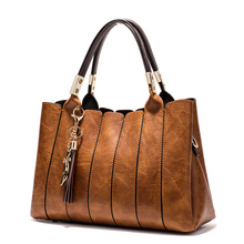 Women Luxury Leather HandBags with tassel fox (4 colors)