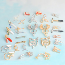 Nurse Doctor Pins Brooches Blood Pressure Meter Neuron Ambulance Uterus Caduceus Massage Reflex Hammer Medical jewelry